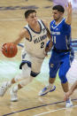 Villanova guard Collin Gillespie (2) moves around Creighton guard Marcus Zegarowski (11) during the first half of an NCAA college basketball game Wednesday, March 3, 2021, in Villanova, Pa. (AP Photo/Laurence Kesterson)