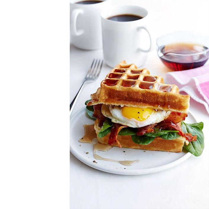 """<p>When you can't choose between waffles and eggs, put them together to make this mouthwatering brunch sandwich.</p><p><a href=""""https://www.womansday.com/food-recipes/recipes/a50558/buttermilk-waffle-bacon-egg-sandwich-recipe-wdy0615/"""" rel=""""nofollow noopener"""" target=""""_blank"""" data-ylk=""""slk:Get the Buttermilk Waffle, Bacon, and Egg Sandwich recipe."""" class=""""link rapid-noclick-resp""""><em>Get the Buttermilk Waffle, Bacon, and Egg Sandwich recipe.</em></a></p>"""