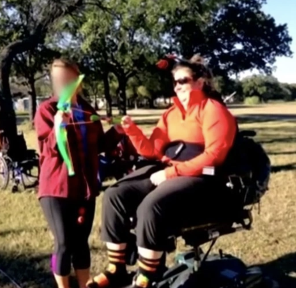Sarah Delashmit, 36, is pictured in a wheelchair.