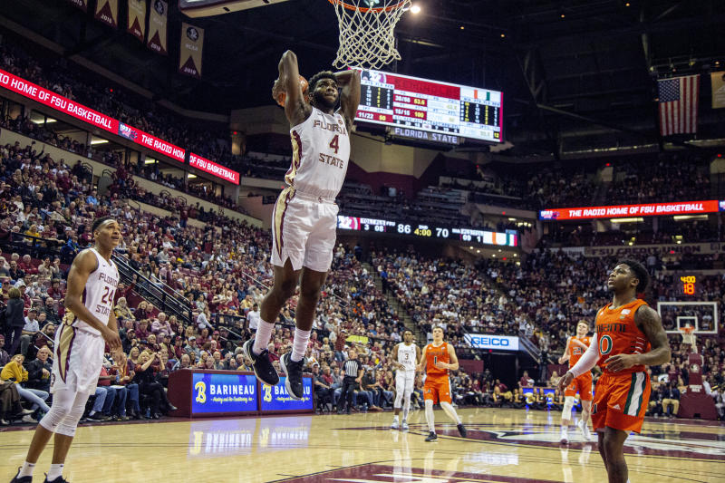 Florida State forward Patrick Williams (4) dunks against Miami in the second half of an NCAA college basketball game in Tallahassee, Fla., Saturday, Feb. 8, 2020. Florida State won 99-81. (AP Photo/Mark Wallheiser)
