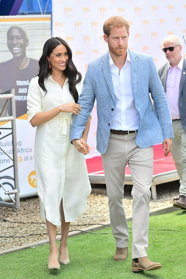 """After her solo outings in various parts of South Africa, Meghan Markle <a href=""""https://people.com/royals/meghan-markle-and-prince-harry-reunite-in-south-africa-to-wrap-their-royal-tour/"""" target=""""_blank"""">reunited with husband Prince Harry</a> for the final day of their royal tour. Meghan looked stunning in a white midi-length shirt dress (her go-to style for the royal tour!), nude pumps, and a pair of red tassel earrings.  <strong>Get the Look!</strong>  VERWIN Long Sleeve Loose Elegant Maxi Shirt Dress, $28.99–$33.99; <a href=""""https://www.amazon.com/VERWIN-Sleeve-Elegant-Button-Pockets/dp/B07HMZBTWH/ref=as_li_ss_tl?dchild=1&keywords=women+midi+white+shirt+dress&qid=1570027463&sr=8-8&linkCode=ll1&tag=poamzfmeghanmarkleafricatourkphillips1019-20&linkId=e4179fcc9a995be9afe38555c2ccfbd6&language=en_US"""" target=""""_blank"""">amazon.com</a>  Donna Karan New York Drawstring Waist Shirt Dress, $135; <a href=""""https://click.linksynergy.com/deeplink?id=93xLBvPhAeE&mid=13867&murl=https%3A%2F%2Fwww.bloomingdales.com%2Fshop%2Fproduct%2Fdonna-karan-new-york-drawstring-waist-shirt-dress%3FID%3D3230693&u1=PEO%2CShopping%3AEveryOutfitMeghanMarkleHasWornonHerRoyalTourinAfrica%28andHowtoGetHerLook%21%29%2Ckamiphillips2%2CUnc%2CGal%2C7319077%2C201910%2CI"""" target=""""_blank"""" rel=""""nofollow"""">bloomingdales.com</a>  Lauren Ralph Lauren Linen Belted Shirtdress, $157.50 (orig. $175); <a href=""""http://www.anrdoezrs.net/links/8029122/type/dlg/sid/PEO,Shopping:EveryOutfitMeghanMarkleHasWornonHerRoyalTourinAfrica(andHowtoGetHerLook!),kamiphillips2,Unc,Gal,7319077,201910,I/https://www.zappos.com/p/lauren-ralph-lauren-belted-linen-shirtdress-white/product/9287044/color/14"""" target=""""_blank"""" rel=""""nofollow"""">zappos.com</a>  Alex Mill Fine Maxi Shirtdress, $93 (orig. $155); <a href=""""https://click.linksynergy.com/deeplink?id=93xLBvPhAeE&mid=1237&murl=https%3A%2F%2Fshop.nordstrom.com%2Fs%2Falex-mill-fine-maxi-shirtdress%2F5241698&u1=PEO%2CShopping%3AEveryOutfitMeghanMarkleHasWornonHerRoyalTourinAfrica%28andHowtoGetH"""