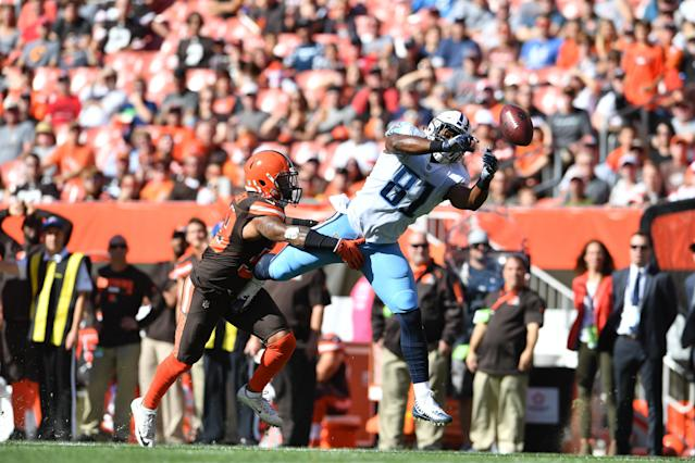 <p>Jonnu Smith #81 of the Tennessee Titans dives to catch a pass defended by Christian Kirksey #58 of the Cleveland Browns in the first quarter at FirstEnergy Stadium on October 22, 2017 in Cleveland, Ohio. The pass was ruled incomplete. (Photo by Jason Miller/Getty Images) </p>