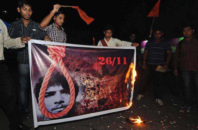 Members of Akhil Bharatiya Vidyarthi Parishad (ABVP) celebrate the news of Mohammed Ajmal Kasab's execution, in Gauhati, India, Wednesday, Nov. 21, 2012. India executed Kasab, the lone surviving gunman from the 2008 Mumbai terror attack early Wednesday, four years after Pakistani gunmen blazed through India's financial capital, killing 166 people and throwing relations between the nuclear-armed neighbors into a tailspin. (AP Photo/Anupam Nath)