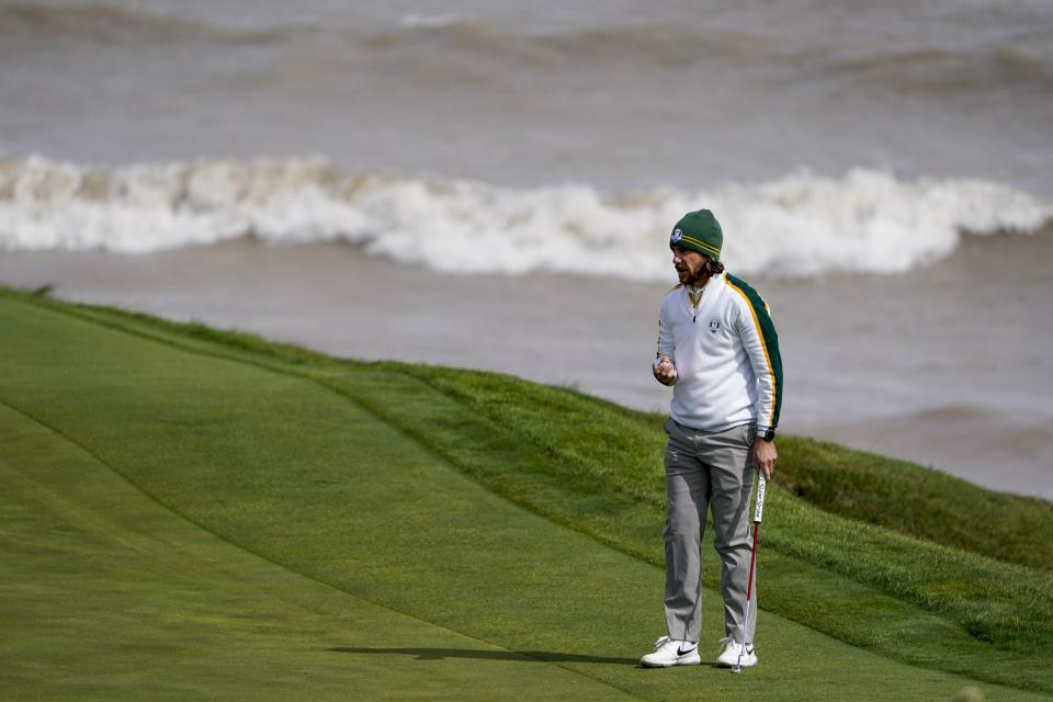 Team Europe's Tommy Fleetwood looks over a shot on the seventh hole during a practice day at the Ryder Cup at the Whistling Straits Golf Course Wednesday, Sept. 22, 2021, in Sheboygan, Wis. (AP Photo/Jeff Roberson)