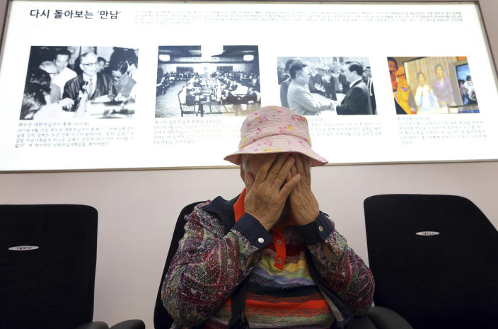 South Korean Cho Jang-geum, 81, weeps as she fills out an application form to reunite with her family members who are living in North Korea, at the headquarters of the Korean Red Cross in Seoul, South Korea, Saturday, Sept. 21, 2013. North Korea on Saturday indefinitely postponed reunions of families separated by the 1950-53 Korean War scheduled to start Wednesday, an apparent setback after weeks of improving ties following springtime threats of war.(AP Photo/Yonhap, Park Dong-ju) KOREA OUT