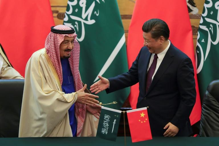 China's President Xi Jinping (right) and Saudi King Salman bin Abdulaziz signed 14 memoranda of understanding during a ceremony at the Great Hall of the People in Beijing, on March 16, 2017