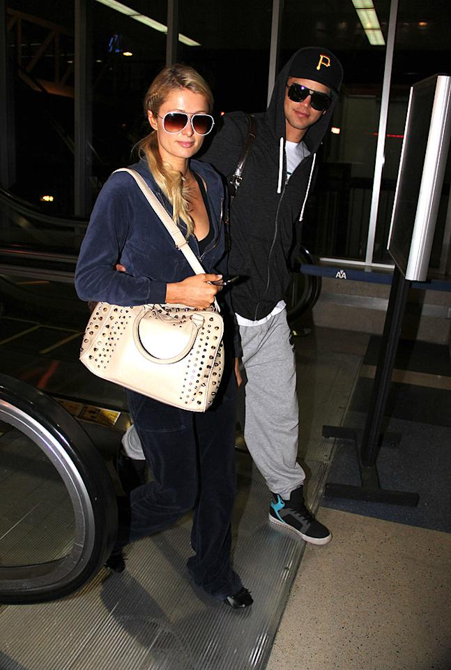 Paris Hilton and River Viiperi arrive back to LAX after a trip to Miami.