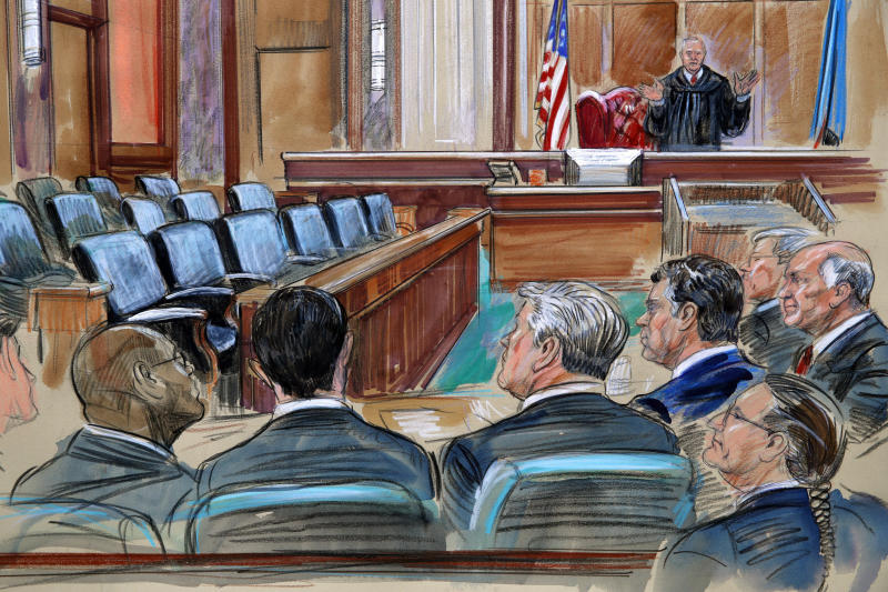 This courtroom sketch depicts U.S. District court Judge T.S. Ellis III speaking to the lawyers and defendant Paul Manafort, fourth from left, as the jury continues to deliberate in Manafort's trial on bank fraud and tax evasion at federal court in Alexandria, Va., Friday, Aug. 17, 2018. Third from left is Manafort's attorney Kevin Downing. (Dana Verkouteren via AP)