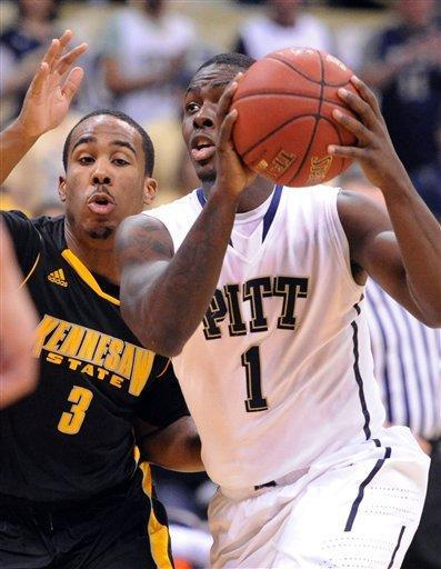Pittsburgh's Tray Woodall drives past Kennesaw State 's Delbert Love in the first half of an NCAA basketball game in Pittsburgh, Sunday, Dec. 23, 2012. (AP Photo/John Heller)