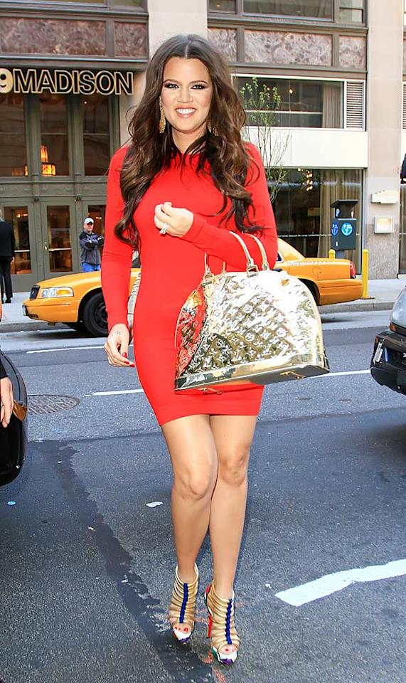 "Forget big sisters Kim and Kourtney, lil' sis Khloe Kardashian is quickly becoming the family's most fashionable member! Check out her fire-engine-red frock, multi-colored Louboutin stilettos, and blindingly metallic Louis Vuitton handbag! Jackson Lee/<a href=""http://www.splashnewsonline.com"" target=""new"">Splash News</a> - April 14, 2010"