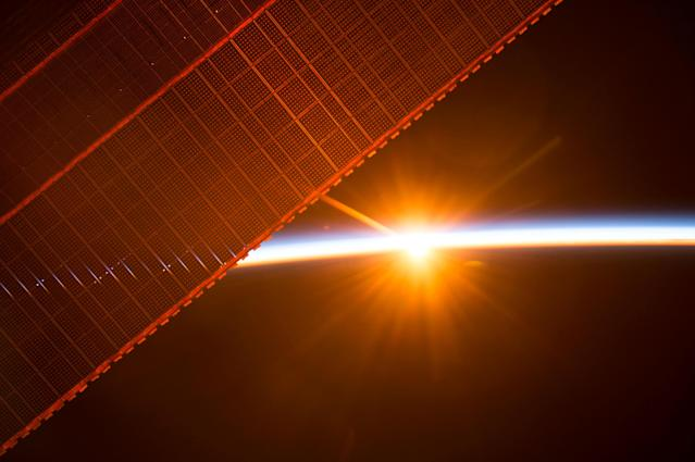 <p>A photo taken on July 26, 2017 by a member of the Expedition 52 crew aboard the International Space Station shows one of the 16 sunrises they experience every day while orbiting Earth. One of the solar panels that provides power to the station is seen in the upper left. (Photo: NASA/Handout via Reuters) </p>