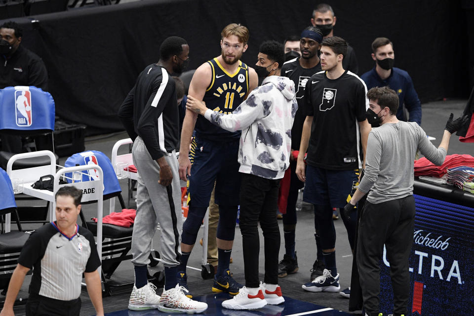 Indiana Pacers forward Domantas Sabonis (11) reacts with teammates in the bench area after fouling out during the second half of the team's NBA basketball Eastern Conference play-in game against the Washington Wizards, Thursday, May 20, 2021, in Washington. (AP Photo/Nick Wass)