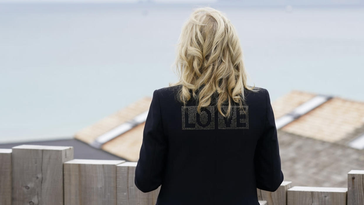 First lady Jill Biden turns around to show the word