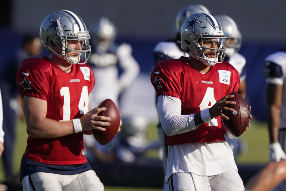 Cowboys quarterback Andy Dalton, pictured at training camp in August with Dak Prescott, was a late free-agent signing for Dallas. (AP Photo/LM Otero)