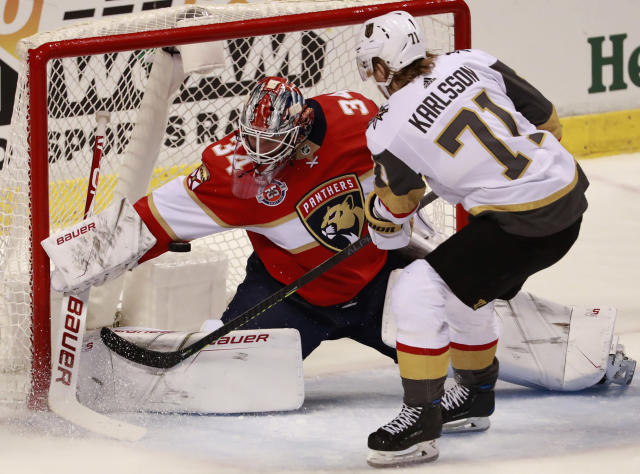 Vegas Golden Knights center William Karlsson (71) attempts to shoot at Florida Panthers goaltender James Reimer (34) during the second period of an NHL hockey game, Saturday, Feb. 2, 2019, in Sunrise, Fla. (AP Photo/Wilfredo Lee)