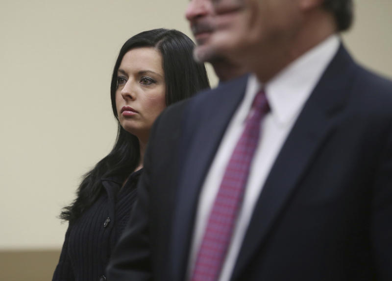 Kimberly Arendt, left, one of the defendants in the Holland Tunnel weapons case, along with John Cramsey and Dean Smith appear before Hudson County Superior Court Judge Mitzy Galis-Menendez in Jersey City, N.J., where they are facing weapons possession charges. (Ed Murray/NJ Advance Media via AP, Pool)