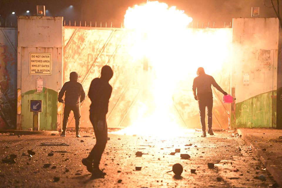 BELFAST, NORTHERN IRELAND - APRIL 07:  Fire fed by petrol burns as youths clashed c on April 7, 2021 in Belfast, Northern Ireland. Violence broke out after a Loyalist protest, with youths attacking police officers and petrol-bombing a bus. (Photo by Charles McQuillan/Getty Images)