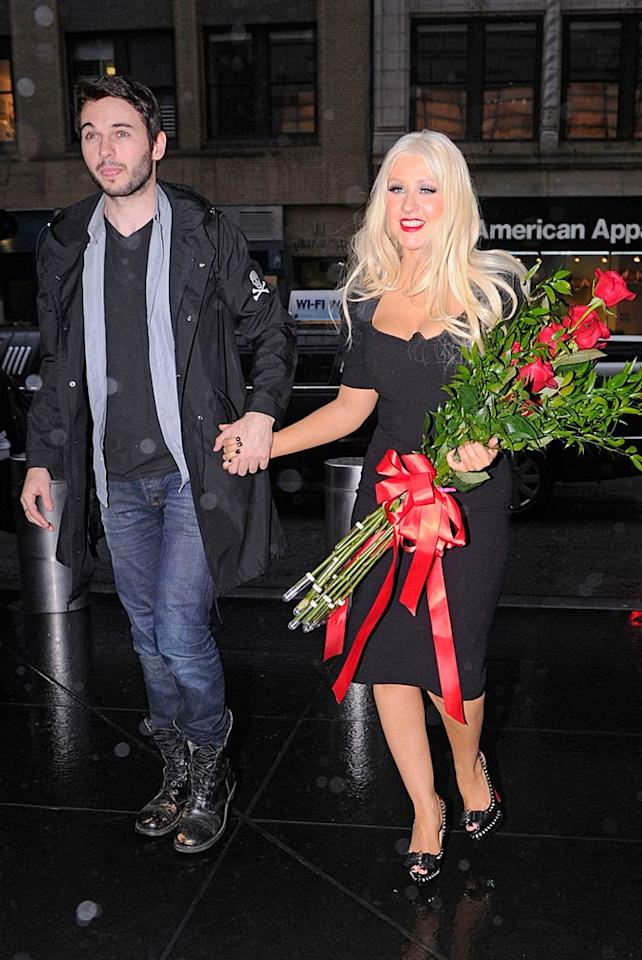 """Christina Aguilera's boyfriend, Matthew Rutler, probably got the credit for the gargantuan bouquet of roses the singer was carrying around in Manhattan, but they were actually a gift from David Letterman in honor of Xtina's appearance on his show Monday night. <a href=""""http://www.pacificcoastnews.com/"""" target=""""new"""">PacificCoastNews.com</a> - May 16, 2011"""