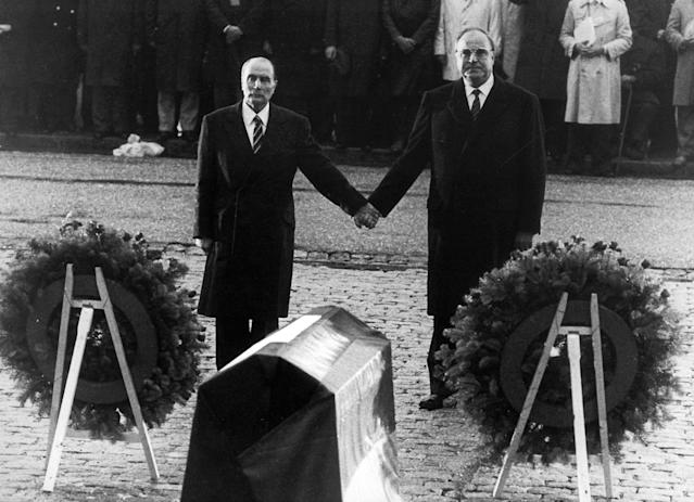 <p>Helmut Kohl (R) stands hand in hand with former French President Francois Mitterrand (L) in this 1984 file photo during their visit to the former Verdun battlefields, Sept. 22, 1984. (Reuters) </p>