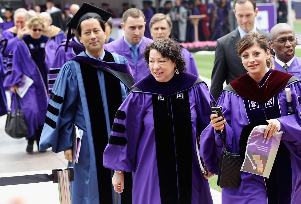 U.S. Supreme Court Justice Sonia Sotomayor (CENTER R) and TV financial journalist Maria Bartiromo (2nd R) depart New York University's commencement ceremony at Yankee Stadium on May 16, 2012 in the Bronx borough of New York City. Sotomayor spoke to a crowd of more than 27,000 at the ceremony and was raised in a Bronx housing project not far from the stadium.   (Photo by Mario Tama/Getty Images)