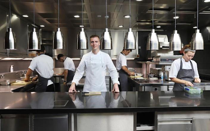 Head Chef Ed Cooke and other chefs at work in the kitchen observing social distancing - John Lawrence