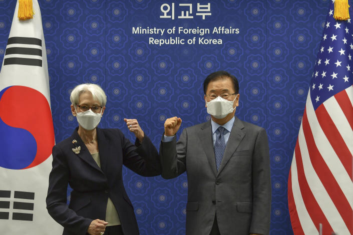 U.S. Deputy Secretary of State Wendy Sherman bumps elbows with South Korean Foreign Minister Chung Eui-yong prior to their meeting at Foreign Ministry in Seoul, South Korea, Thursday, July 22, 2021. The United States, Japan and South Korea on Wednesday reaffirmed their commitment to work together on North Korea's denuclearization and other regional threats but made no progress in bringing closer together the two U.S. allies. (Song Kyung-seok/Pool Photo via AP)