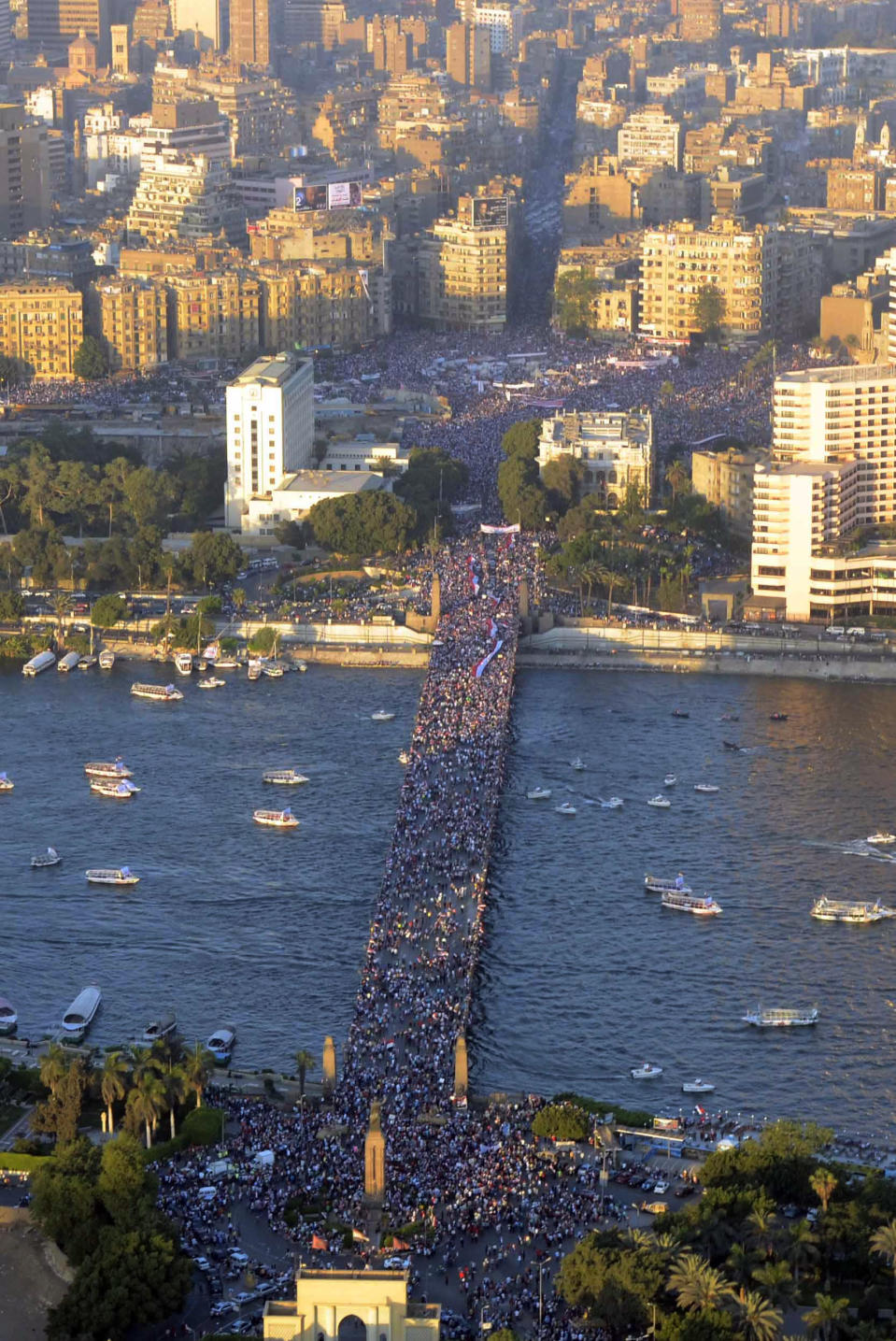 In this Friday, July 26, 2013, photo released on Saturday, July 27, by the Egyptian army, opponents of Egypt's ousted President Mohammed Morsi protest at Tahrir Square, upper part, and on a bridge over the Nile river in Cairo, Egypt. Security forces clashed with supporters of Egypt's ousted president early Saturday in the country's bloodiest incidence of violence since the military deposed Morsi. (AP Photo/Hossam Diab, Egyptian army)