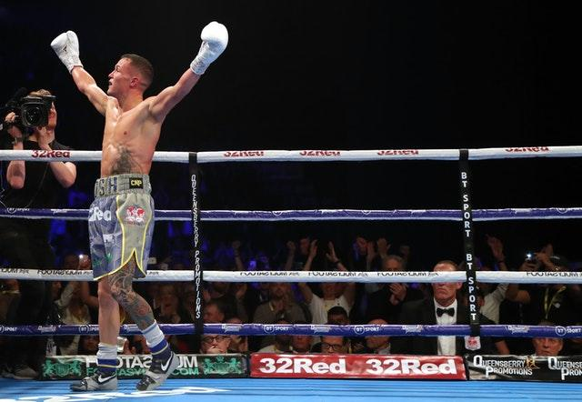 Josh Warrington celebrates defeating Sofiane Takoucht (Richard Sellers/PA)