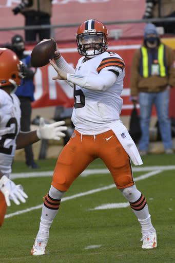 Cleveland Browns quarterback Baker Mayfield throws a pass during the second half of an NFL divisional round football game against the Kansas City Chiefs, Sunday, Jan. 17, 2021, in Kansas City. The Chiefs won 22-17. (AP Photo/Reed Hoffmann)