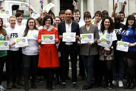 Labour Party MP Chuka Umunna, Liberal Democrat MP Layla Moran and Green MP Caroline Lucas  stand with activists as they pose at the launch of the Peoples Vote advertising campaign in central London,  Britain April 15, 2018. REUTERS/Simon Dawson