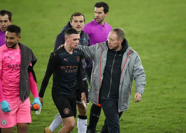 Manchester City's Phil Foden, left, with Swansea manager Steve Cooper