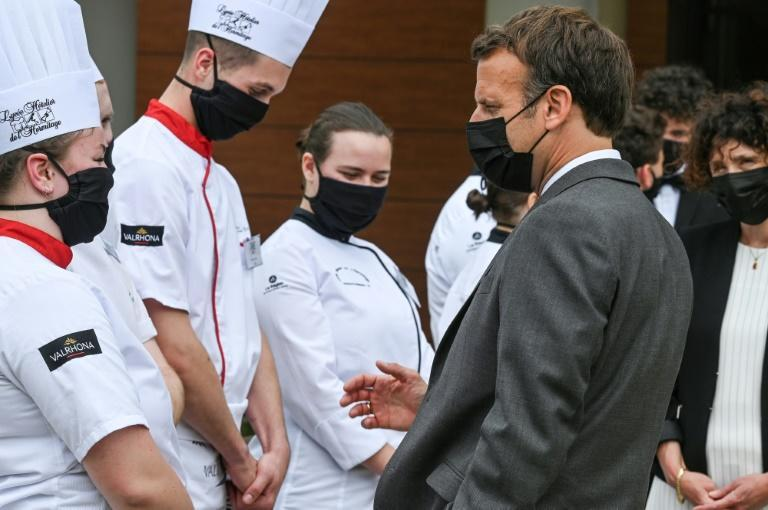 Macron talks with students at the Hospitality school in Tain l'Hermitage during the second stop of his nationwide tour