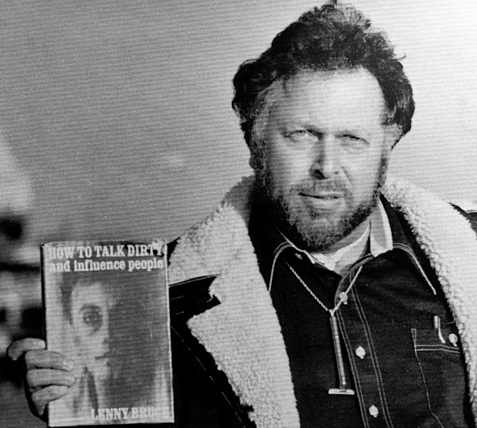FILE - In this Oct. 25, 1977 file photo, pornographic magazine publisher Al Goldstein displays some of his reading material upon leaving the federal courthouse in Kansas City, Kan., where his obscenity trial resumed. Goldstein, the bird-flipping publisher of Screw magazine who helped break down legal barriers against pornography and raged against politicians, organized religion and anything that even suggested good taste, died at a Brooklyn hospice Thursday after a long illness, according to a friend, attorney Charles C. DeStefano. He was 77. (AP File Photo)