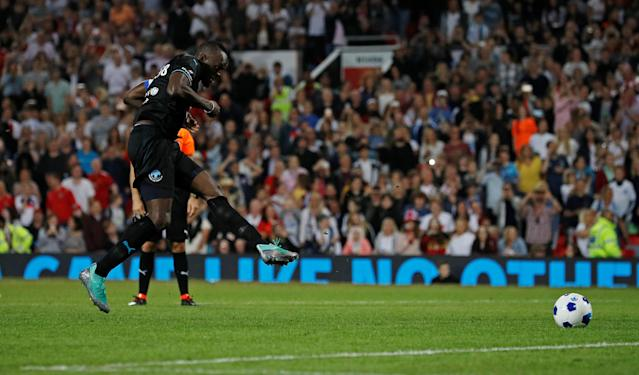 Soccer Football - Soccer Aid 2018 - England v Soccer Aid World XI - Old Trafford, Manchester, Britain - June 10, 2018 World XI's Usain Bolt scores during the penalty shootout REUTERS/Phil Noble