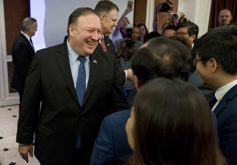 Secretary of State Mike Pompeo greets members of the audience after speaking at a Business Community ‎Reception at the Metropole Hotel in Hanoi, Vietnam, Sunday, July 8, 2018. Pompeo is on a trip traveling to North Korea, Japan, Vietnam, Abu Dhabi and Brussels. (AP Photo/Andrew Harnik, Pool)