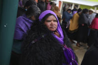 Indigenous Tzotzil women wait to vote in a non-binding national referendum on whether Mexican ex-presidents should be tried for any illegal acts during their time in office, in the Corazon de Maria community of Chiapas state, Mexico, Sunday, Aug. 1, 2021. (AP Photo/Emilio Espejel)