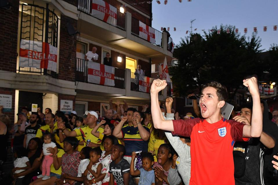 <p>England and Colombia fans watched the match side by side on the Kirby Estate in Bermondsey, south London as England won in a dramatic penalty shootout (Picture: PA) </p>