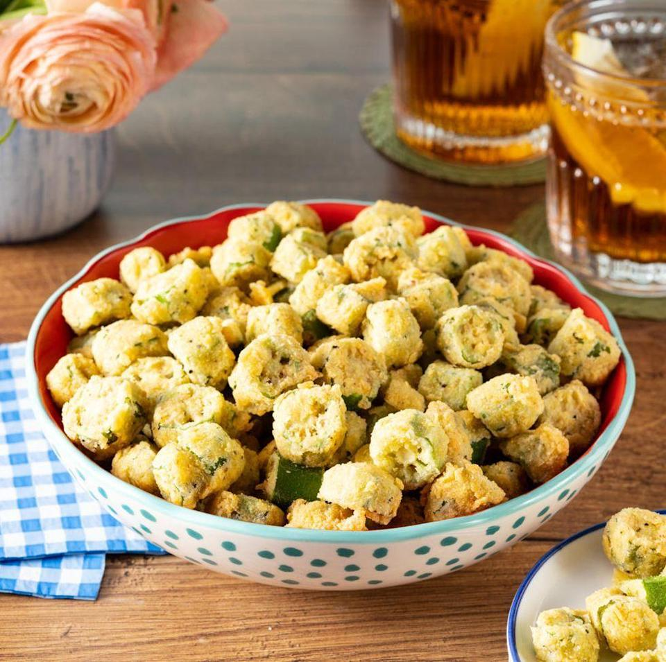 """<p>Pair this finger food with your Southern Thanksgiving menu. It has a crispy golden crust made from flavorful cornmeal—yum! </p><p><a href=""""https://www.thepioneerwoman.com/food-cooking/recipes/a35881049/southern-fried-okra-recipe/"""" rel=""""nofollow noopener"""" target=""""_blank"""" data-ylk=""""slk:Get the recipe."""" class=""""link rapid-noclick-resp""""><strong>Get the recipe.</strong></a></p>"""