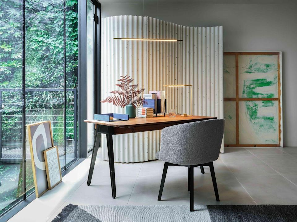 """<p>Made in Portugal by De La Espada and available at Heal's, this desk designed by Matthew Hilton is available in a choice of walnut or oak. Its pointed legs elegantly reference the furniture styles of the mid-century. £3,876, <a href=""""https://www.heals.com/orson-desk.html"""" rel=""""nofollow noopener"""" target=""""_blank"""" data-ylk=""""slk:heals.com"""" class=""""link rapid-noclick-resp"""">heals.com</a></p>"""