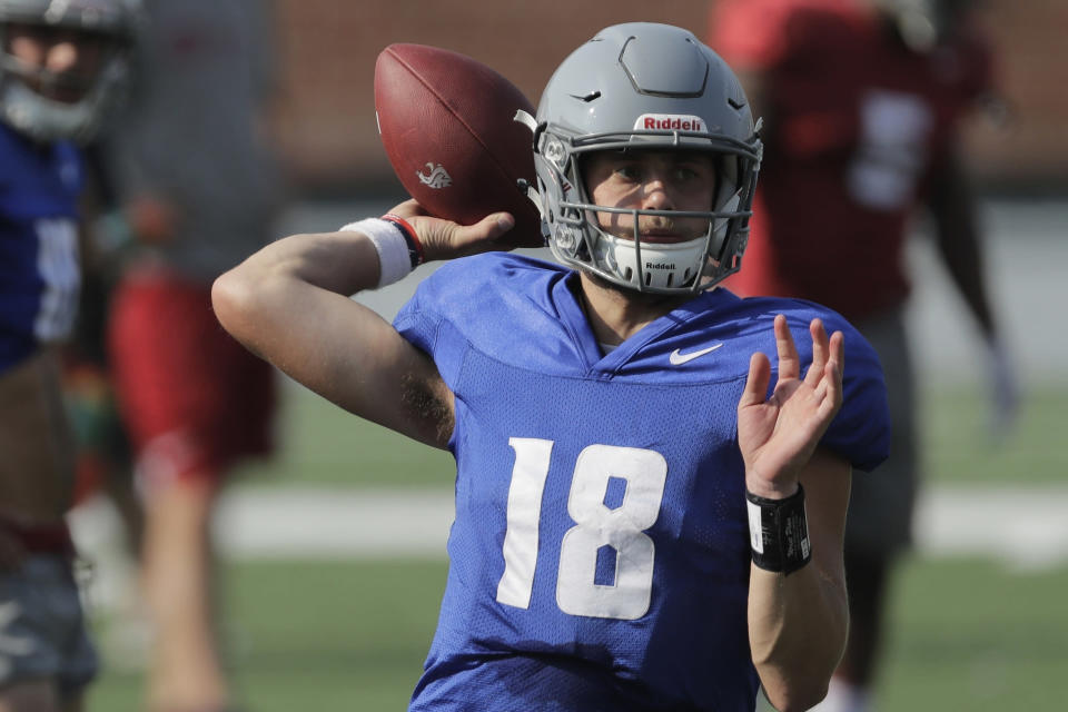 FILE - In this Aug. 16, 2018, file photo, Washington State quarterback Anthony Gordon passes during NCAA college football practice, in Pullman, Wash. Gordon has big shoes to fill. (AP Photo/Ted S. Warren, File)