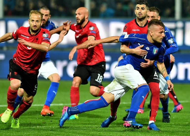 Italy's forward Ciro Immobile escapes from Albania's defender Elseid Hysaj during the FIFA World Cup 2018 qualification football match March 24, 2017