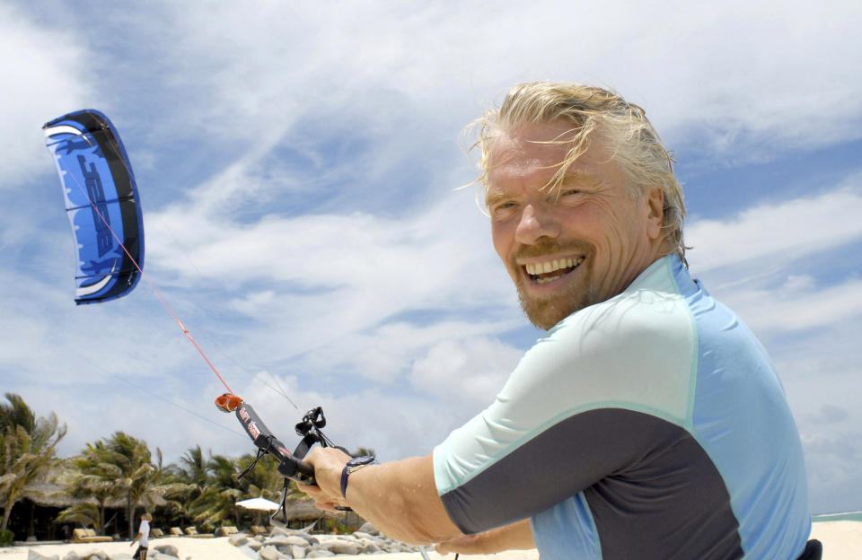 Richard Branson prepares to go kite-boarding near his private resort and home, on Necker Island, British Virgin Islands, Sunday, June 8, 2008. Branson, a high school dropout who built his Virgin empire into a world brand, said he plans for his newest property, nearby Mosquito Island, to be transformed into what he touts as the most environmentally-friendly resort on the globe. (AP Photo/Todd VanSickle)