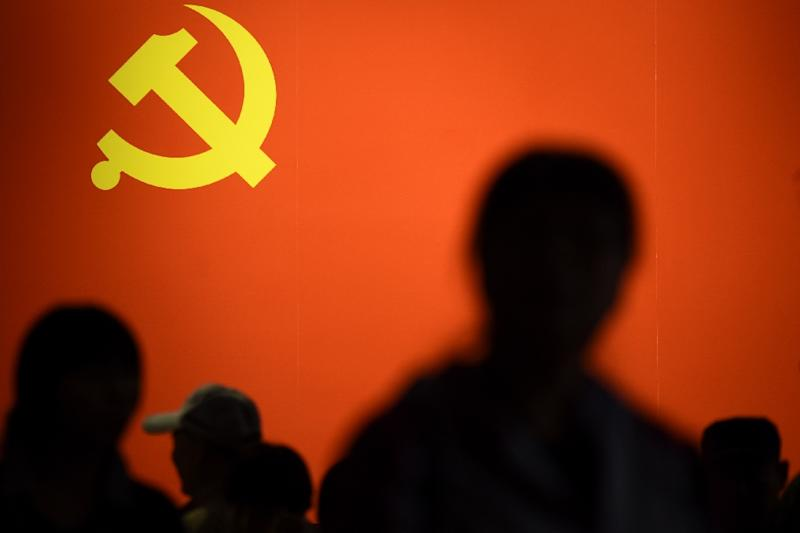 Chinese authorities swiftly punish those who deface leaders' images and other Communist symbols (AFP Photo/WANG ZHAO)