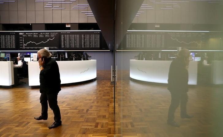 A trader at the Frankfurt stock exchange reacts on late afternoon trading results in Frankfurt