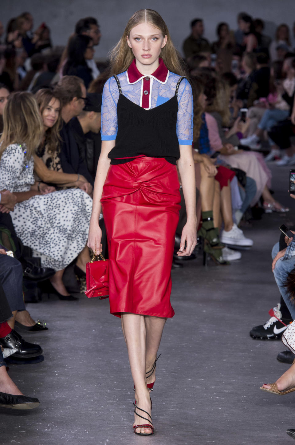 <p><i>Model wears a red and blue lace polo shirt and red leather skirt from the SS18 No.21 collection. (Photo: ImaxTree) </i></p>