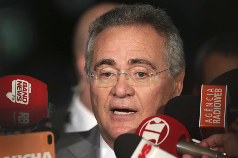 """Senate leader Renan Calheiros speaks during a press conference at the National Congress, in Brasilia, Brazil, Tuesday, Dec. 6, 2016. A Brazilian Supreme Court justice on Monday ordered the Senate leader and a key ally of the president removed from his post because he is being investigated for corruption. In a shocking move on Tuesday, Calheiros refused to step down until the full Supreme Court ruled, calling it a """"monarchic decision."""" (AP Photo/Eraldo Peres)"""