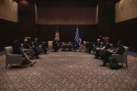 U.S. Secretary of State Mike Pompeo, background left, Greek Foreign Minister Nikos Dendias, background right, and their delegations join a meeting in the northern city of Thessaloniki, Greece, Monday, Sept. 28, 2020. Pompeo and Dendias, will sign a bilateral science and technology agreement, as well as host energy sector business leaders for a discussion to highlight energy diversification and infrastructure projects in Greece. (AP Photo/Giannis Papanikos, Pool)