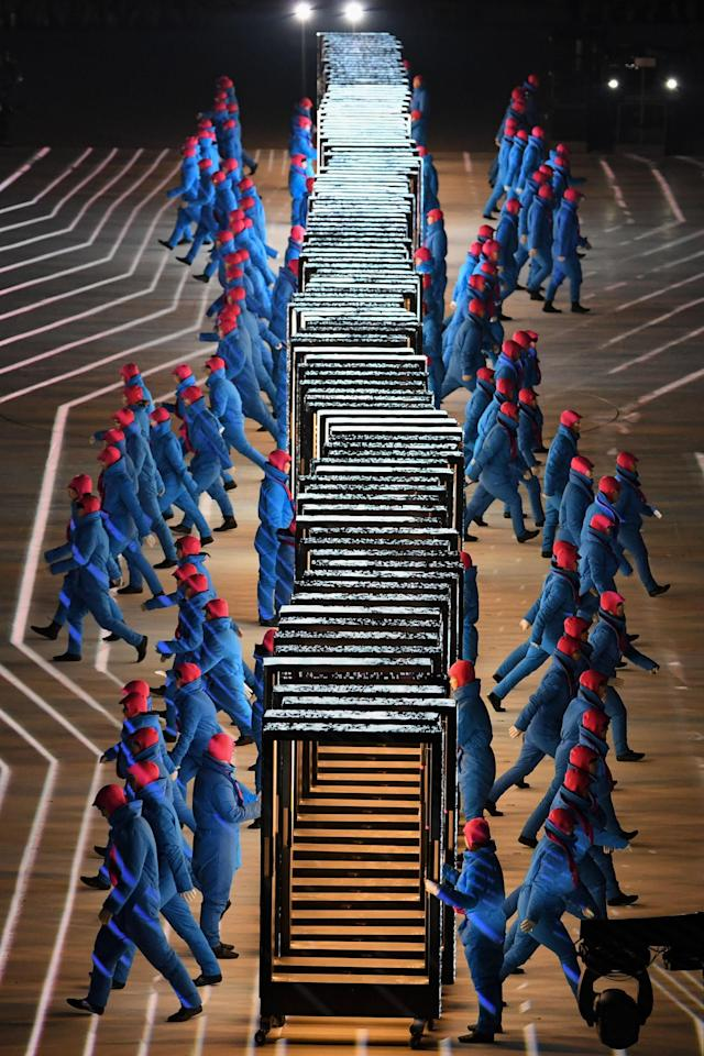<p>Performer walk during the opening ceremony of the Pyeongchang 2018 Winter Olympic Games at the Pyeongchang Stadium on February 9, 2018. / AFP PHOTO / Martin BUREAU </p>