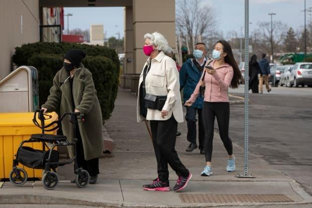 Toronto residents line up at a COVID-19 mass vaccination clinic at the East York Town Centre mall in the city's Thorncliffe Park neighbourhood on March 24, 2021.