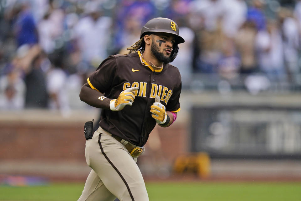 San Diego Padres' Fernando Tatis Jr. reacts after hitting a grand slam during the seventh inning of a baseball game against the New York Mets at Citi Field, Sunday, June 13, 2021, in New York. (AP Photo/Seth Wenig)